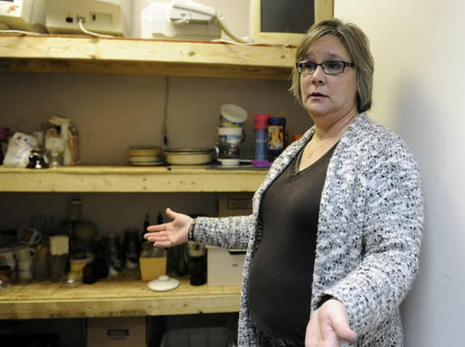 In this Feb. 26, 2016, photo, standing in a supply closet, Shawn Baker talks about her new career in Houston. After Baker was laid off from a job building power units for offshore oil rigs she went into business for herself with an offbeat idea called Tantrums,� a paid service that lets customers take out their frustrations by smashing plates, televisions and other objects in various rooms with sledgehammers, bats and pipes. (AP Photo/Pat Sullivan) Photo: Pat Sullivan