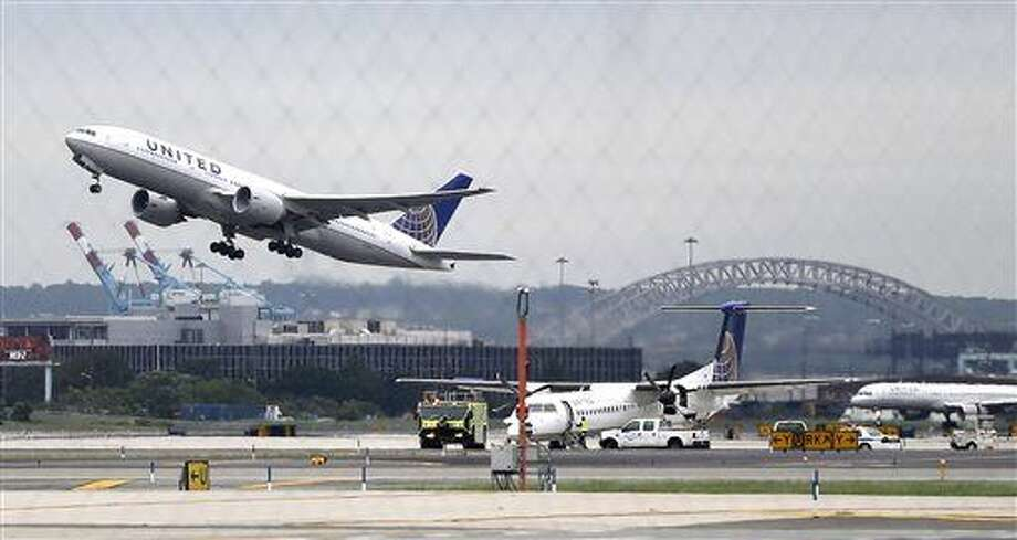 FILE - In this July 25, 2013 file photo, a United Airlines plane, top left, takes off from Newark Liberty International Airport, in Newark, N.J. The three largest U.S. airlines have changed the way they price multi-city trips, forcing those who book such itineraries to pay hundreds of extra dollars in airfare. Most fliers buy simple roundtrip tickets and won't be affected. But travelers visiting several cities on one trip, especially those flying for business, are seeing airfares six or seven times the normal price. (AP Photo/Julio Cortez) Photo: Julio Cortez