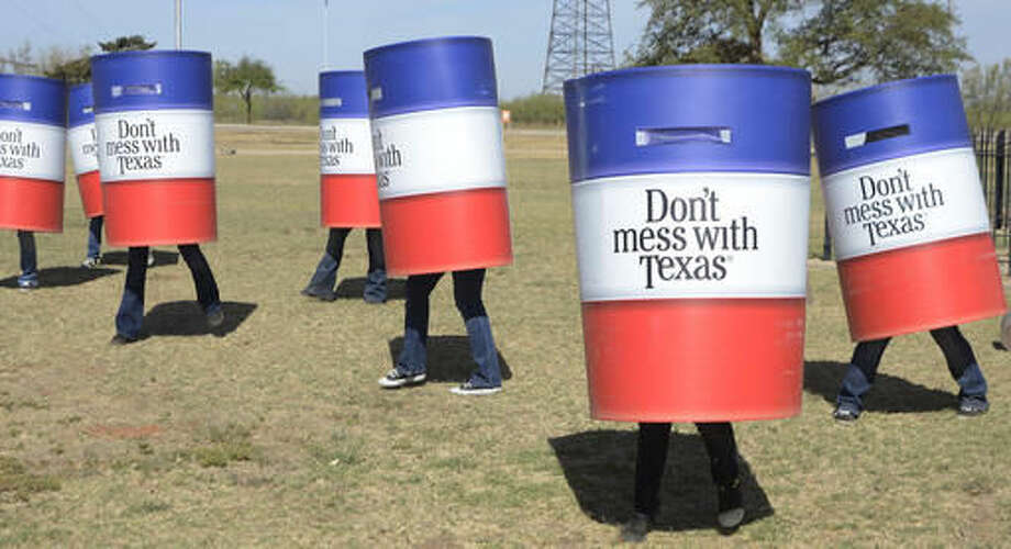 FILE - In this April 12, 2013 file photo, members of the Odessa College Cheer Team dress as trash cans and dance to the Don't Mess with Texas song during a news conference to promote Texas Department of Transportation's litter clean up 'can'paign in Midland, Texas. The Don't Mess With Texas anti-litter campaign has been around for 30 years with more chances to pick up trash across the state. (Mark Sterkel/The Odessa American, via AP, File) Photo: Mark Sterkel
