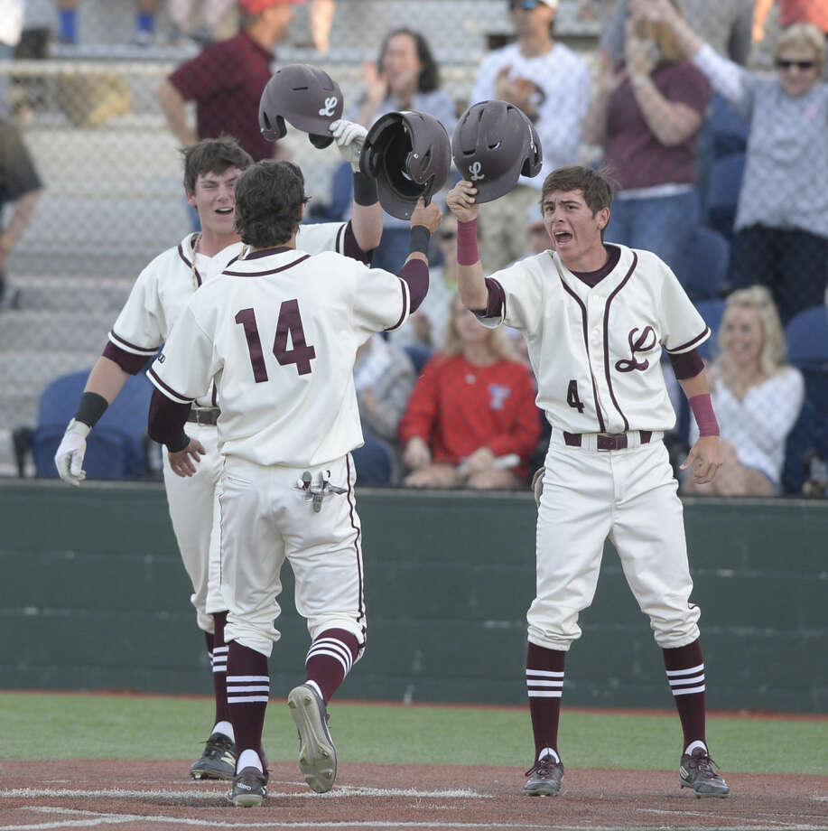 Lee's Garrett Chalker (14) crosses home plate while being congratulated by teammates Blake Blessie (9) and Tristan Martinez (4) during the game against Midland High on Tuesday, April 5, 2016, at Christensen Stadium. James Durbin/Reporter-Telegram Photo: James Durbin