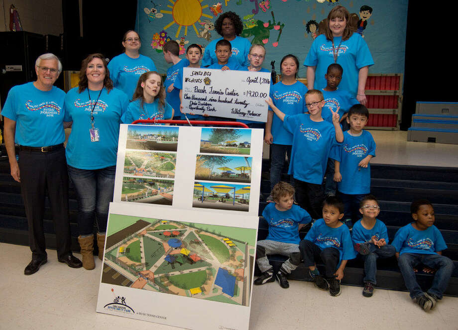 Close to $2,000 was presented Friday for Opportunity Park. On hand for the presentation were: Wanda Niblett, top row left, and Shawndell Barron; Sherry Ruiz, second row, from left, Shay Sykes, Josiah Medina, Jeremiah Rodriguez, Sarah Bruehl, Chuyun Thomas and Abdul Falana; Steve Davidson, third row, from left, Whitney Nolasco, Caroline Daniels, Riley Rodgers and Jayden Pham-Le; and Kaden Robinson, bottom row from left, Jeriah Camiring, Aaron Gutierrez and Samuel Adigun. Photo: Tim Fischer\Reporter-Tel­egram