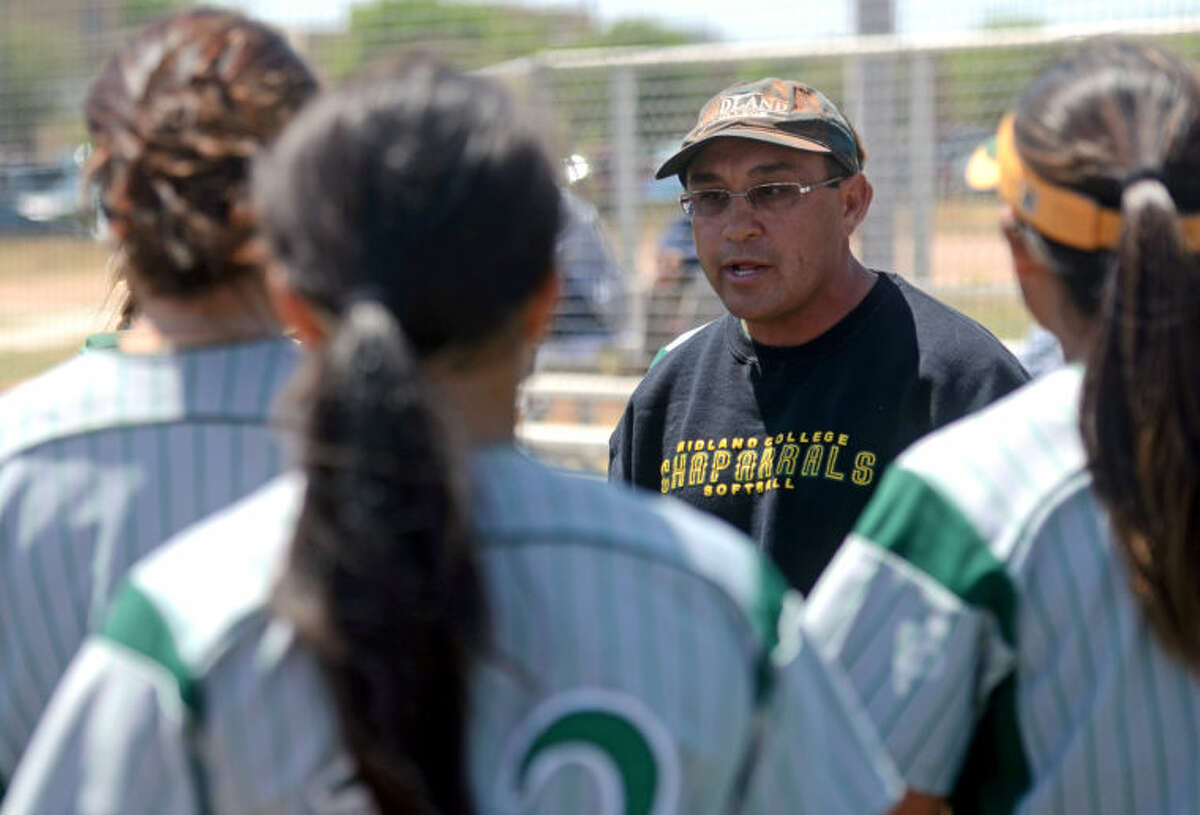 Midland College softball head coach Tommy Ramos talks with his team between innings during the game against Howard last season at the Midland College softball field. James Durbin/Reporter-Telegram