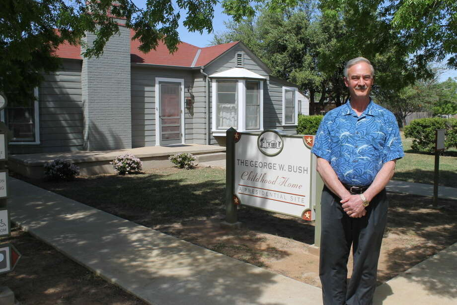 Executive director Paul St. Hilaire stands in front of the Bush home before their 10th anniversary celebration.