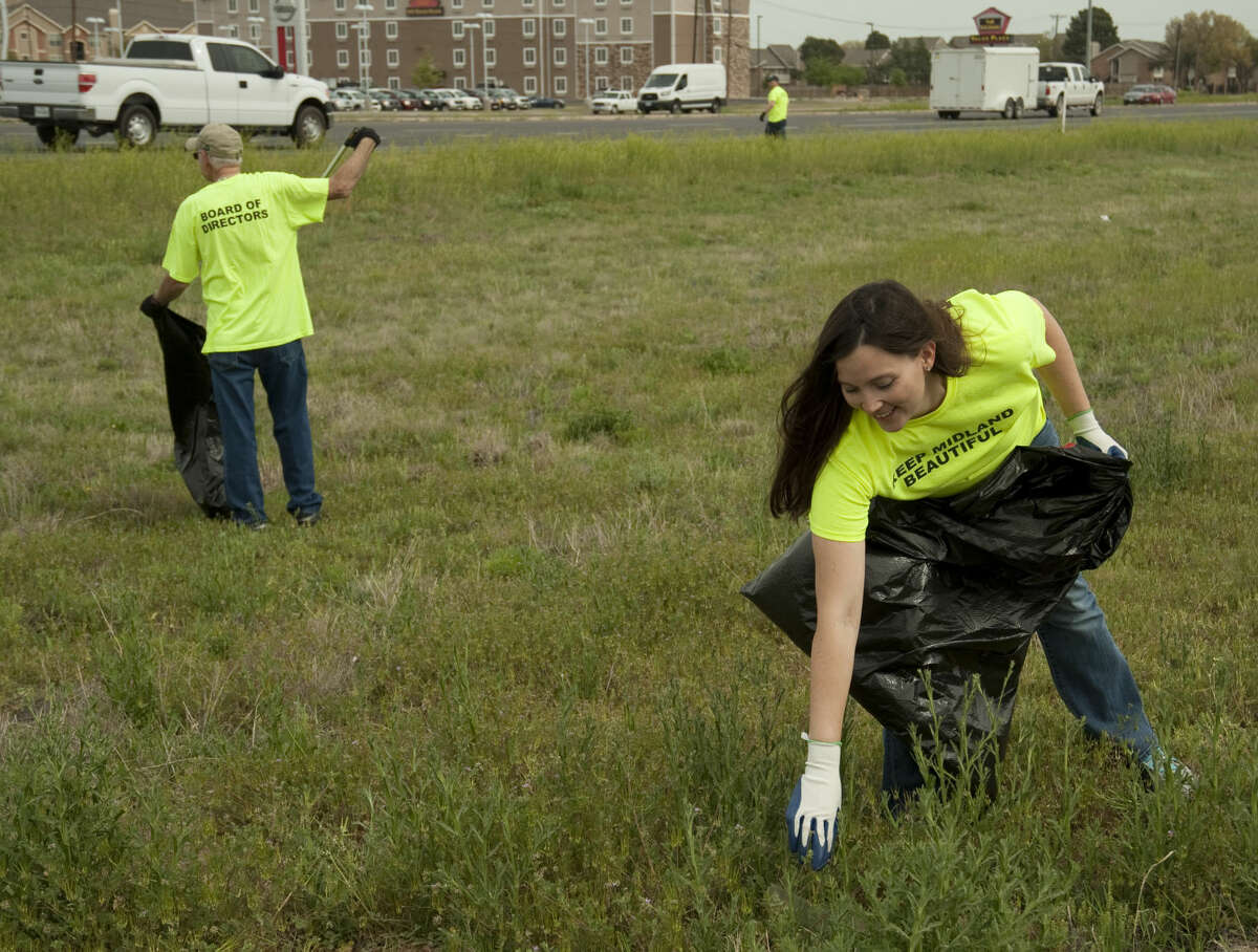 Amanda Byrom, executive director of Keep Midland Beautiful, and other board members clean up trash along Loop 250 Tuesday, 3-31-15, on the southside service road. Tim Fischer\Reporter-Telegram