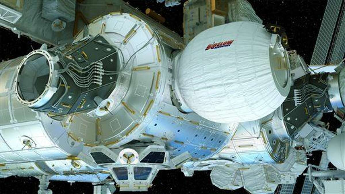This image provided by Bigelow Aerospace on April 6, 2016 shows an illustration of the Bigelow Expandable Activity Module (BEAM), center right, attached to the International Space Station. It's a technology demonstration meant to pave the way for moon bases and Mars expeditions, as well as orbiting outposts catering to scientists and tourists. (Bigelow Aerospace via AP)