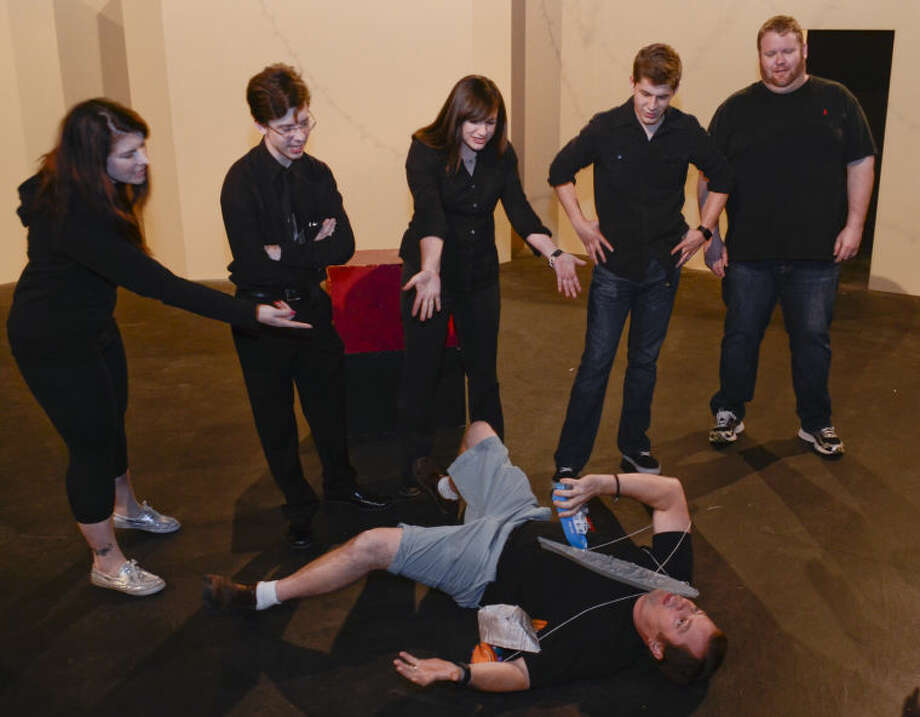 Joe Thomason lies dead on the floor as Ashley Sexton, Ben Spencer, Jessica Sparkman, Brandon Sanchez and Scott Windham look on in MCT's production of The Complete Works of William Shakespeare. Tim Fischer\Reporter-Telegram Photo: Tim Fischer