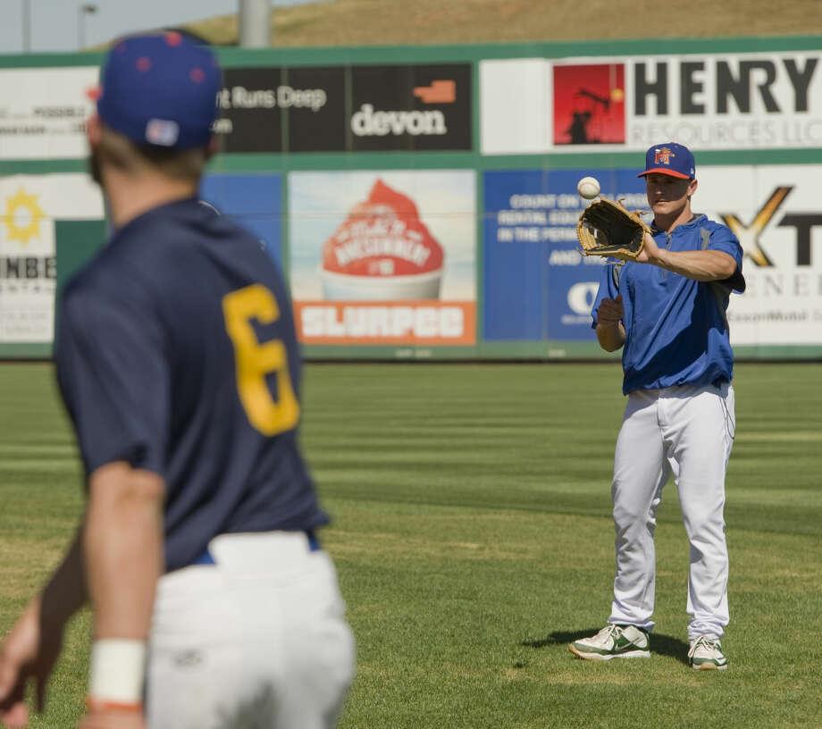 Midland RockHounds' Matt Chapman and other players get in a light workout Monday 04-04-16 at Security Bank Ballpark. Tim Fischer\Reporter-Telegram Photo: Tim Fischer