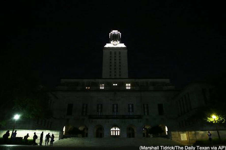 "The University of Texas tower is darkened in honor of student Haruka Weiser, 18, on Thursday night, April 7, 2016, in Austin, Texas. Weiser, a first-year University of Texas dance student whose body was found near the heart of campus was the victim of a ""horrifying and incomprehensible"" killing that was the first on school grounds since the bell tower mass shooting nearly 50 years ago, university officials said Thursday. A vigil was held Thursday evening where hundreds of students, faculty, and staff gathered in remembrance of Weiser. (Marshall Tidrick/The Daily Texan via AP) MANDATORY CREDIT Photo: Marshall Tidrick"
