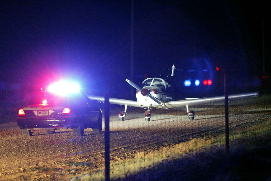 A small private aircraft made an emergency landing on South County Road 1218 near the intersection of East County Road 180 after experiencing engine trouble on the evening of Friday, April 3, 2015. James Durbin/Reporter-Telegram Photo: James Durbin