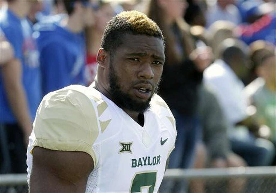 FILE - In this Oct. 10, 2015, file photo, then-Baylor defensive end Shawn Oakman warms up before an NCAA college football game against Kansas, in Lawrence, Kan. Texas authorities are investigating allegations by a woman who says she was sexually assaulted by former Baylor defensive end Shawn Oakman. According to a Waco police affidavit, a woman told police that Oakman sexually assaulted her early Sunday morning. Oakman hasn't been charged and a police spokesman declined Friday, April 8, 2016, to comment on the investigation. (AP Photo/Charlie Riedel, File)
