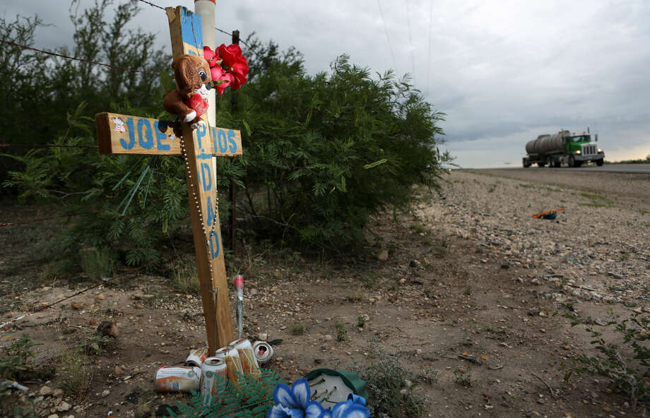 Rios' wife Cindy erected a cross for her husband Joe at the site where he was killed in January 2014 after the van he was riding in struck a school bus. The 111-mile-long highway has had more than 20 fatal accidents reported since 2011 - including four major crashes that killed three or four people and involved oilfield workers or commercial haulers. Photo: Mayra Beltran