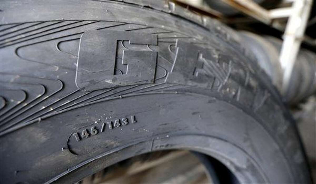 This March 18, 2015 photo shows the load index, 146/143, and speed rating, L, on a popular size semi-tractor trailer tire, at a truck tire shop in Houston. The L speed rating indicates that 75 mph is the maximum speed at which this tire can carry a load weighing 6,614 pounds at the recommended air pressure. (AP Photo/David J. Phillip)