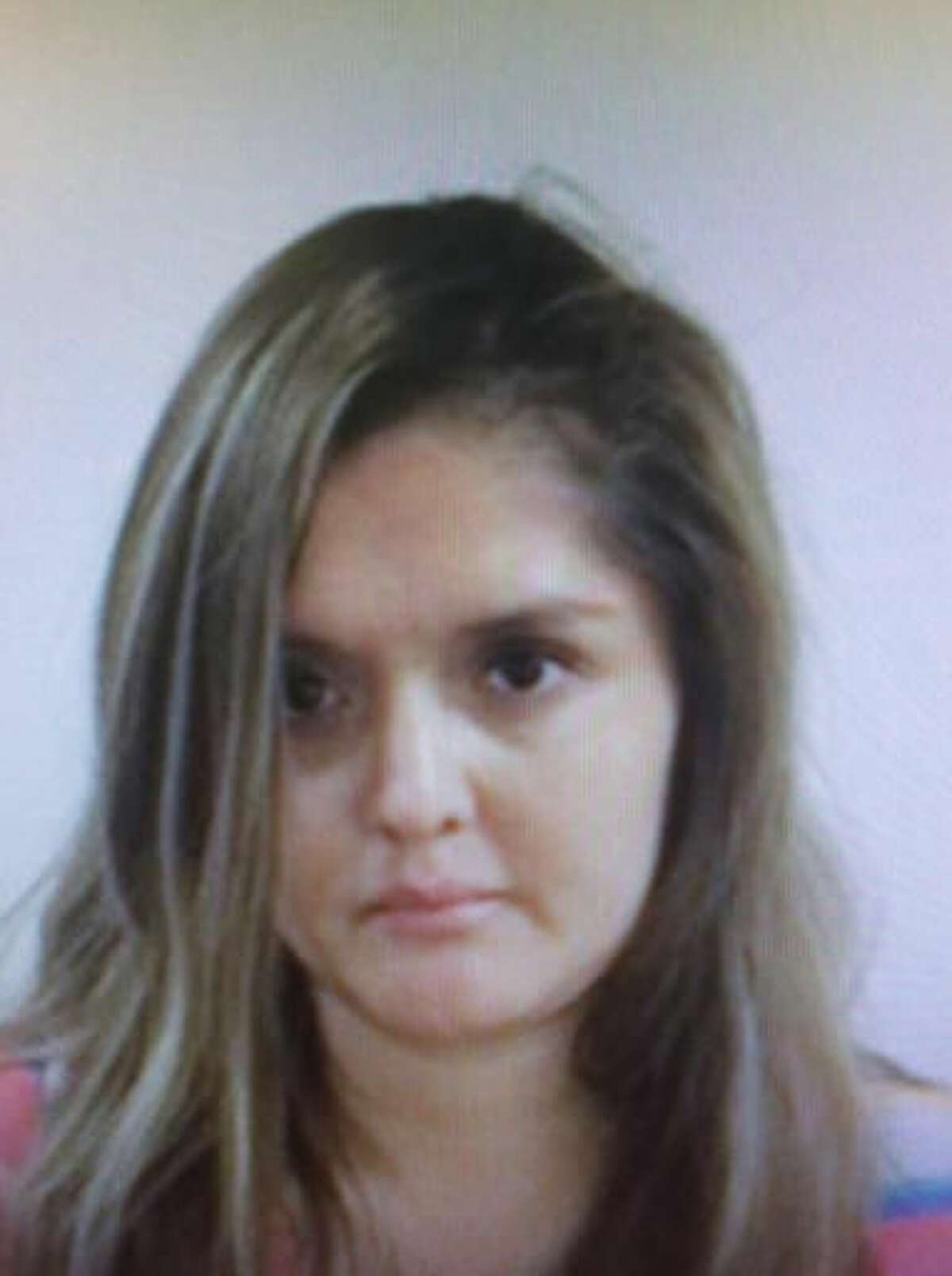 This undated handout photo provided by the FBI shows Brenda Delgado. The Dallas woman accused of arranging for a hit man to kill a dentist who was dating her ex-boyfriend has been added to the FBI's 10 Most Wanted fugitives list Wednesday, April 6, 2016. Delgado is wanted for capital murder and unlawful flight to avoid prosecution. (FBI via AP)