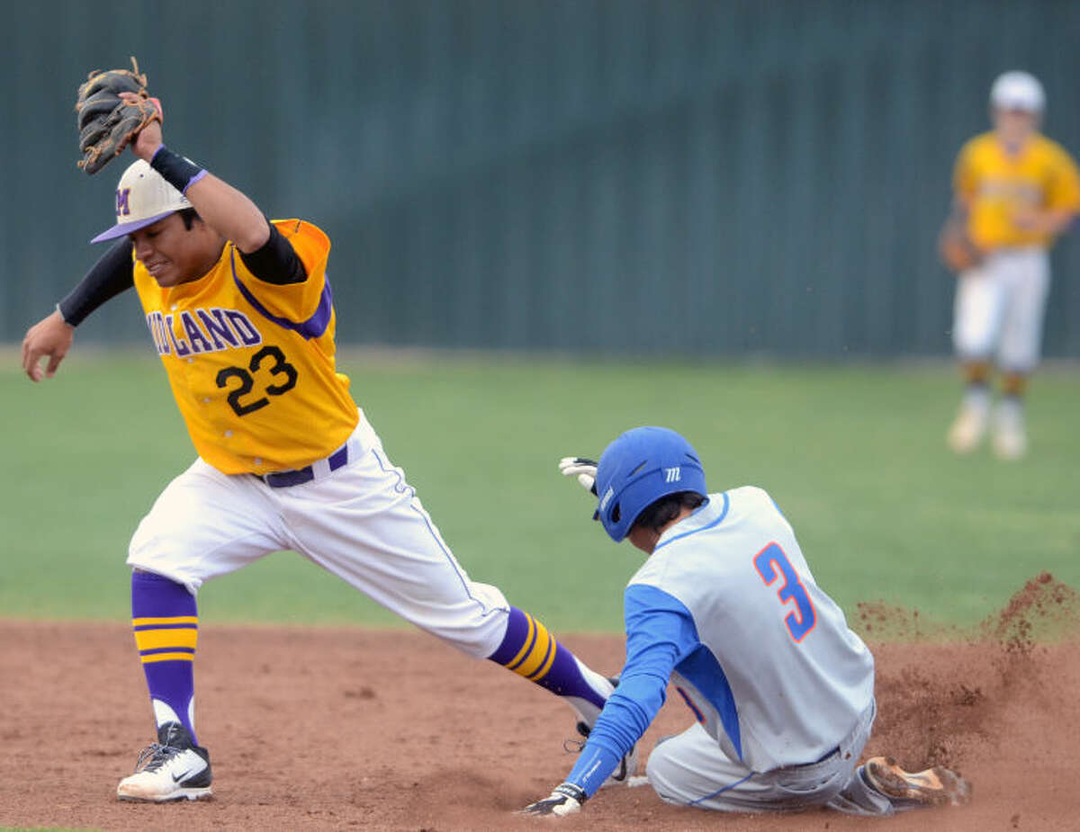 Midland High's Gilbert Sanchez gets an out at second base against San Angelo Central on Tuesday at Zachery Field. James Durbin/Reporter-Telegram