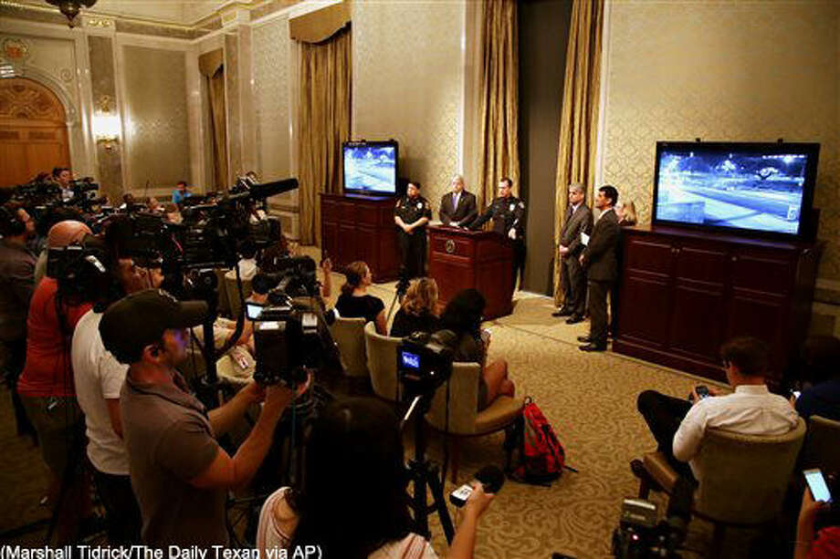 Austin Police Department shows a video of the homicide suspect during a news conference about the death of University of Texas student Haruka Weiser on Thursday, April 7, 2016, in Austin, Texas. The first-year dance student was the victim of a homicide and police are searching for a man seen near the heart of campus, where her body was found. (Marshall Tidrick/The Daily Texan via AP) MANDATORY CREDIT Photo: Marshall Tidrick