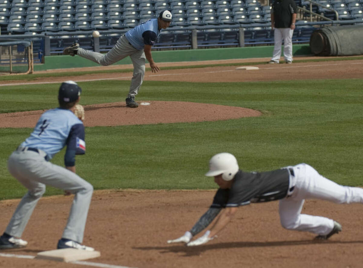 Greenwood's Ismael Madrid throws to first on a pickoff attempt as Forsan's Polo Morin Sr. beats the ball as Greenwood's Austin Ulcak reaches Friday at Security Bank Ballpark. Tim Fischer\Reporter-Telegram