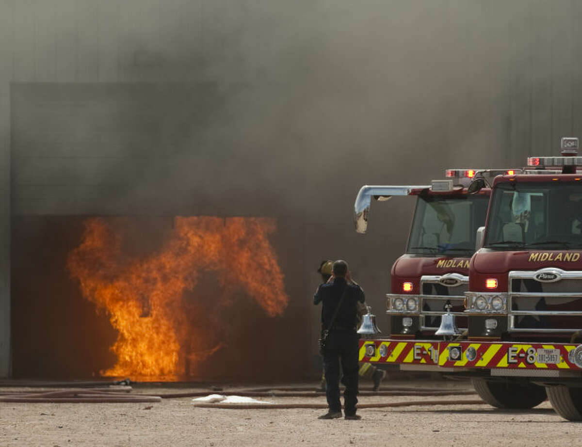 Midland fire personnel respond to an explosion and fire Friday afternoon at Warrior Energy Services off I-20. Tim Fischer\Reporter-Telegram