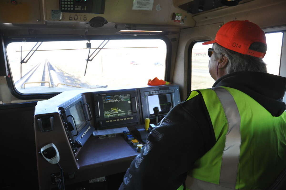 Union Pacific engineer Lewis Castillas drives a locomotive west of Midland during a media day Wednesday.