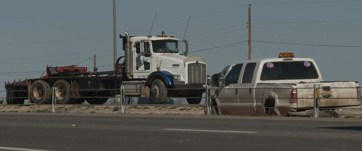 A jack-knifed semi and many smaller accidents closes the east bound lane of I-20 west of Loop 250 near mile marker 130 on Tuesday, March 24 15, as crews work to remove the truck and cars from the roadway. Tim Fischer\Reporter-Telegram