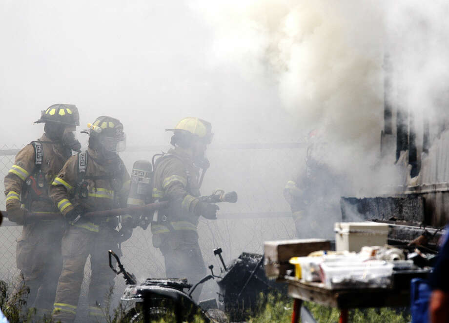 Midland emergency personnel work to extinguish a fire at a mobile home near S. Midkiff Rd and West County Road 118 on Friday, March 3, 2015. James Durbin/Reporter-Telegram Photo: James Durbin