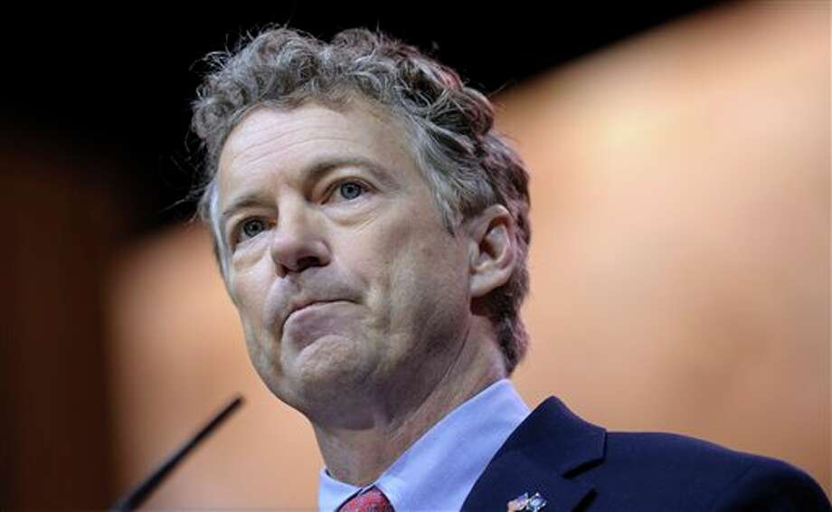 Sen. Rand Paul, R-Ky., speaks at the Conservative Political Action Committee annual conference in National Harbor, Md., Friday, March 7, 2014. Friday marks the second day of the annual Conservative Political Action Conference, which brings together prospective presidential candidates, conservative opinion leaders and tea party activists from coast to coast. (AP Photo/Susan Walsh) Photo: Susan Walsh / AP