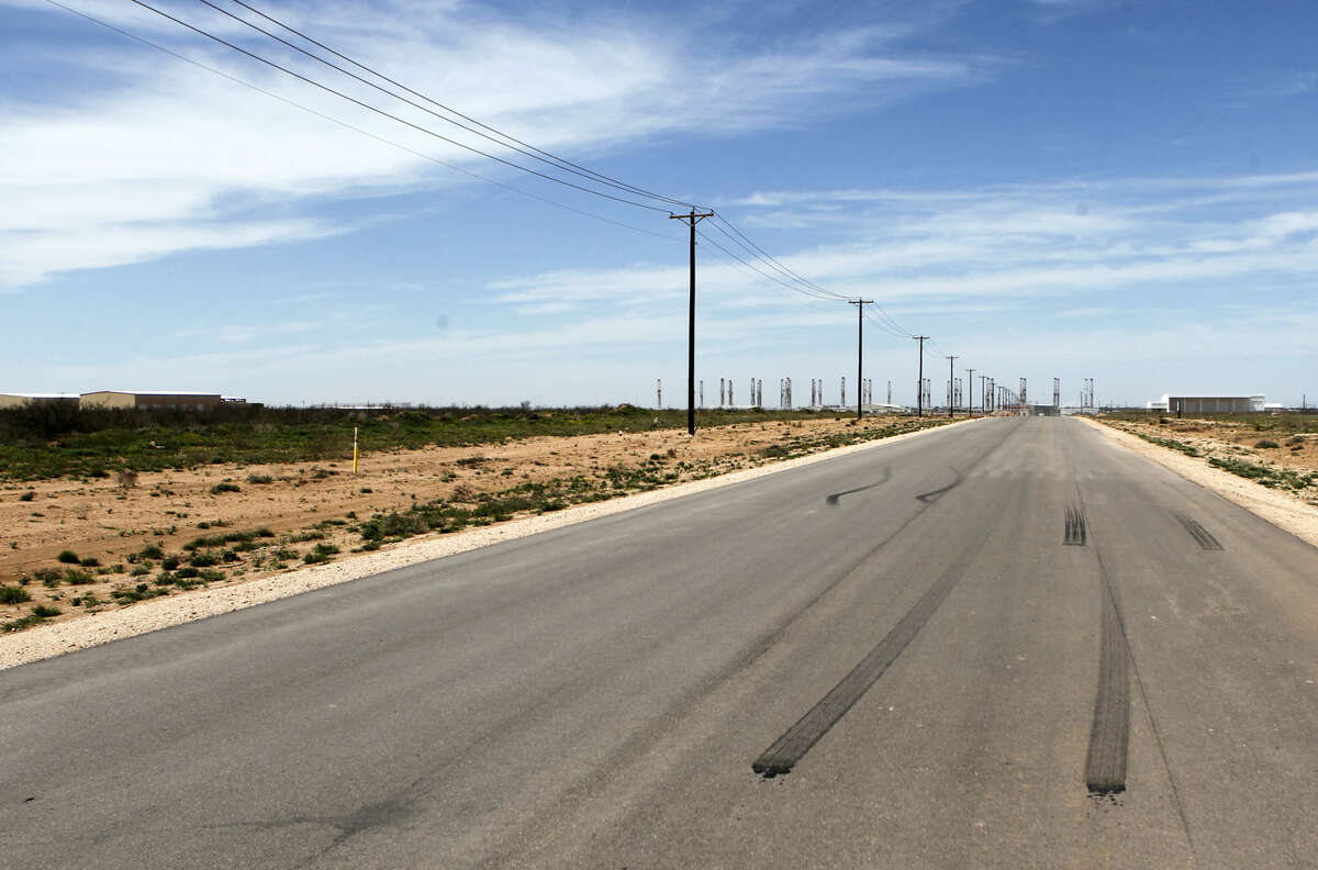 Burned rubber laid down by spinning vehicle tires on a 1.2 mile stretch of Faudree south of Interstate 20, photographed Thursday, April 2, 2015. The area has been connected to reports of recent arrests for street racing. James Durbin/Reporter-Telegram