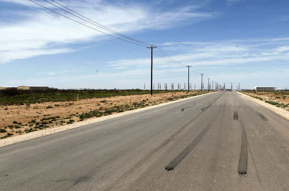 Burned rubber laid down by spinning vehicle tires on a 1.2 mile stretch of Faudree south of Interstate 20, photographed Thursday, April 2, 2015. The area has been connected to reports of recent arrests for street racing. James Durbin/Reporter-Telegram Photo: James Durbin