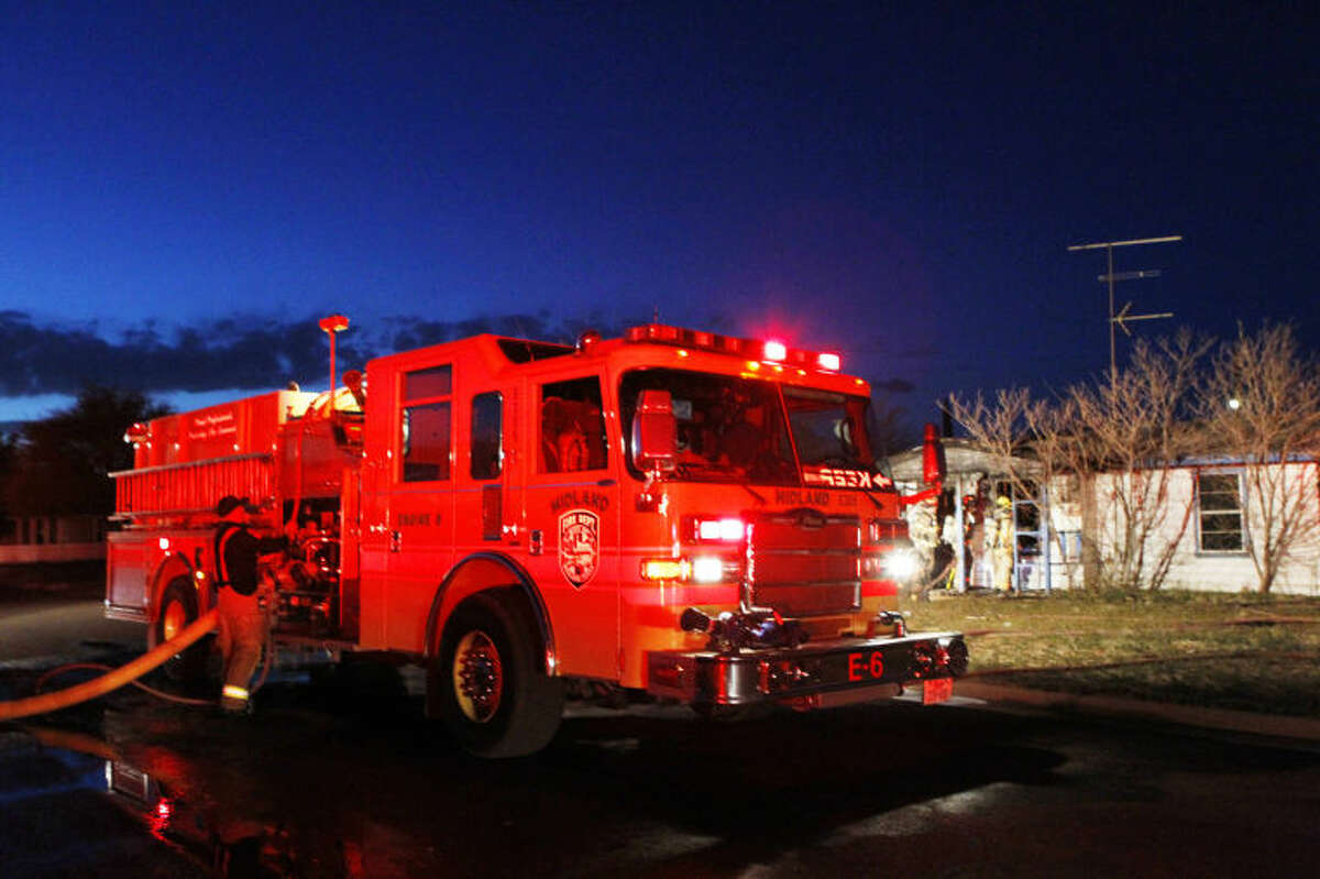 Midland emergency personnel respond to a structure fire on Cedar Spring Drive on Friday. James Durbin/Reporter-Telegram