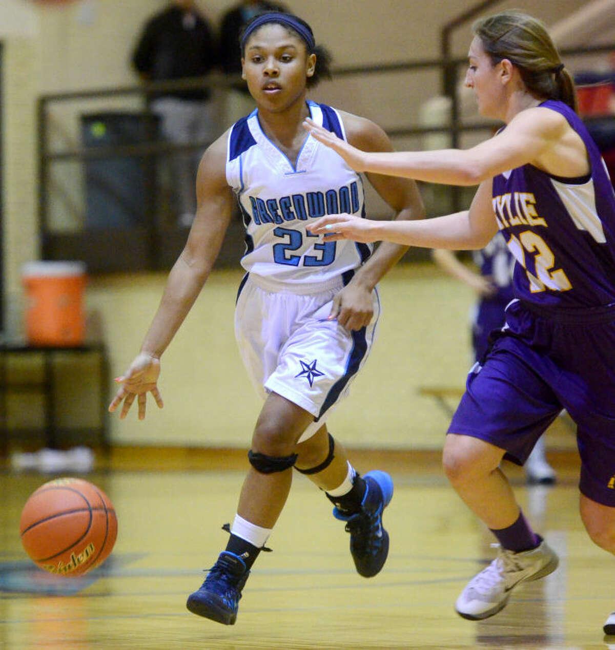 Greenwood's Oriana Ortiz (23) takes the ball down the court against Abilene Wylie's Ragan Henson (12) on Jan. 31 at Greenwood. James Durbin/Reporter-Telegram