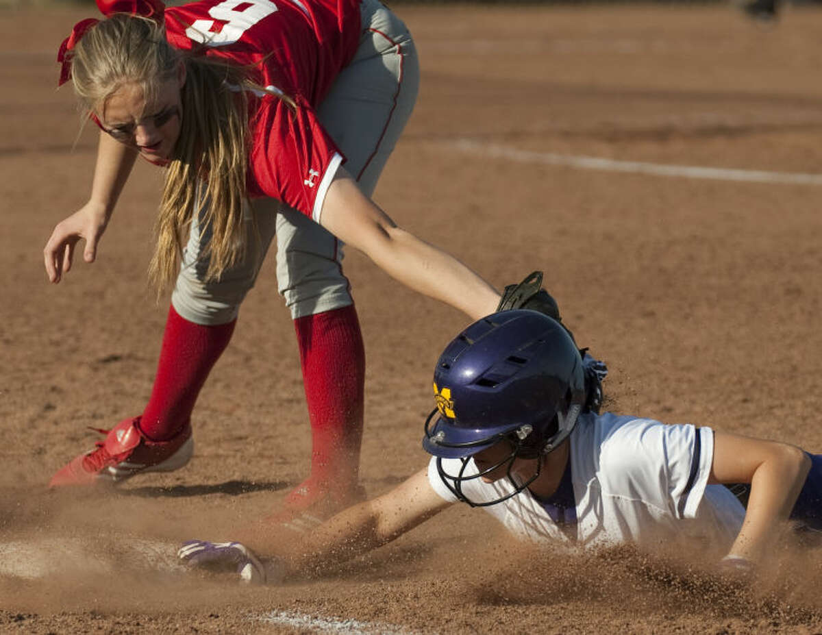 Midland High's Brittany Baggett beats the tag back to first on a pickoff attempt from home as Lubbock Coronado's Kaitlyn Dawson tries to make the tag Friday afternoon at Audrey Gill Sports Complex. Tim Fischer\Reporter-Telegram