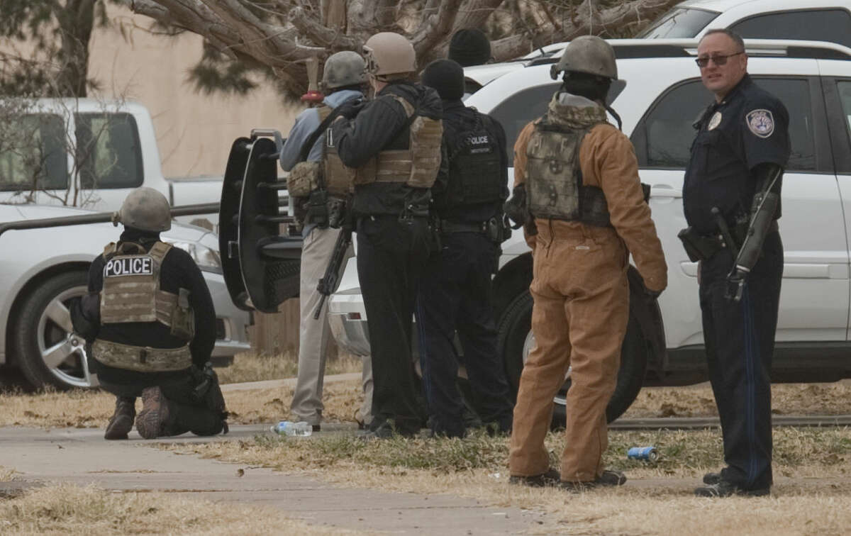 Midland police and SWAT units respond to an armed subject Monday morning in the 2700 block of W. Washington. Tim Fischer\Reporter-Telegram