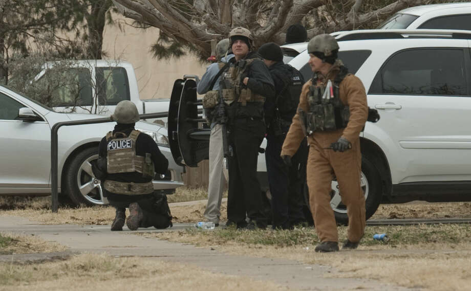 Midland police and SWAT units respond to an armed subject Monday morning in the 2700 block of W. Washington. Tim Fischer\Reporter-Telegram Photo: Tim Fischer