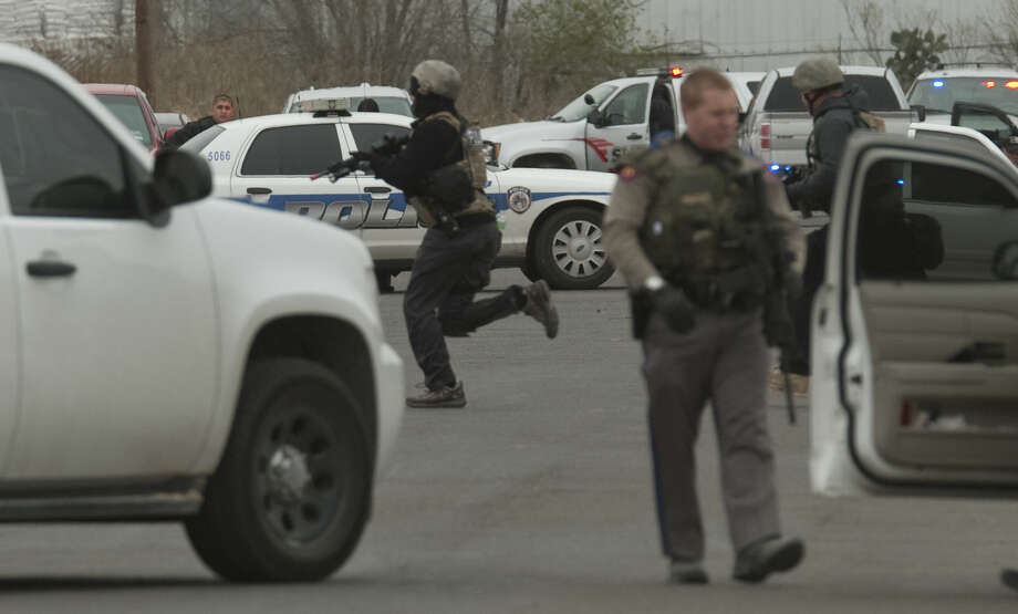 Midland police and SWAT units respond to an armed subject earlier this month Photo: Midland Reporter-Telegram