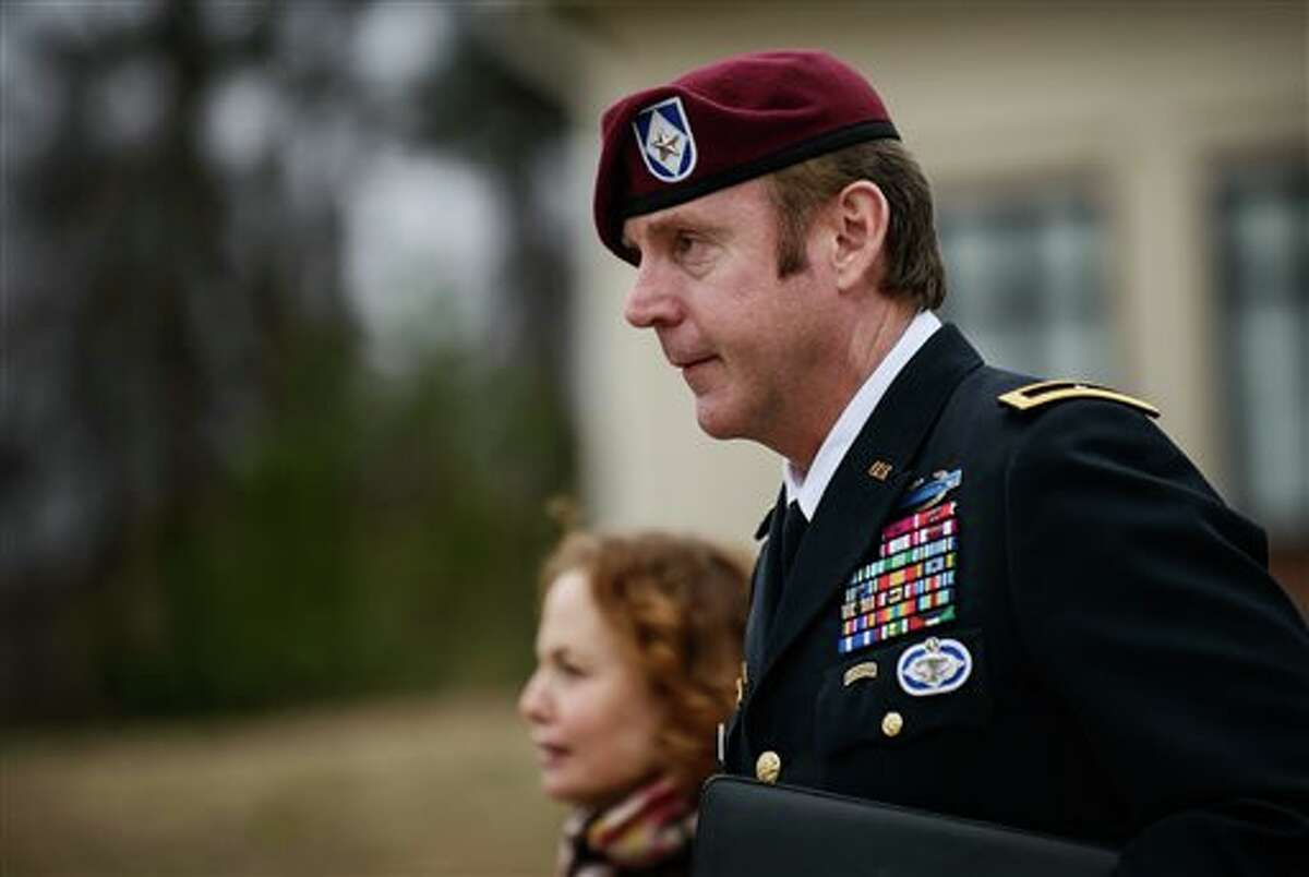 Brig. Gen. Jeffrey Sinclair leaves the courthouse following a day of motions, Tuesday, March 4, 2014, at Fort Bragg, N.C. Less than a month before Sinclair's trial on sexual assault charges, the lead prosecutor broke down in tears Tuesday as he told a superior he believed the primary accuser in the case had lied under oath. (AP Photo/The Fayetteville Observer, James Robinson)