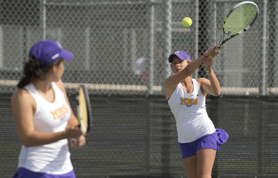 Midland High's doubles team of Sofia Salcedo and Ellie Hord returns a shot Thursday 04-07-16 during a match at the Bush Tennis Center during the District 3-6A tennis championships. Tim Fischer\Reporter-Telegram