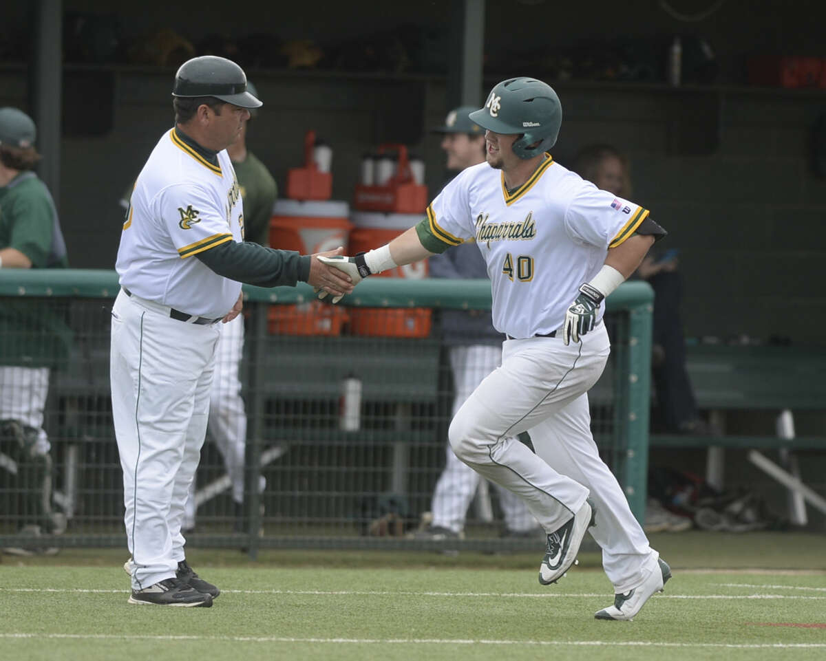 Midland College's Tony Beam (40) is congratulated by head coach David Coleman while running the bases on a home run hit against Odessa College on Friday, April 8, 2016, at Christensen Stadium. James Durbin/Reporter-Telegram