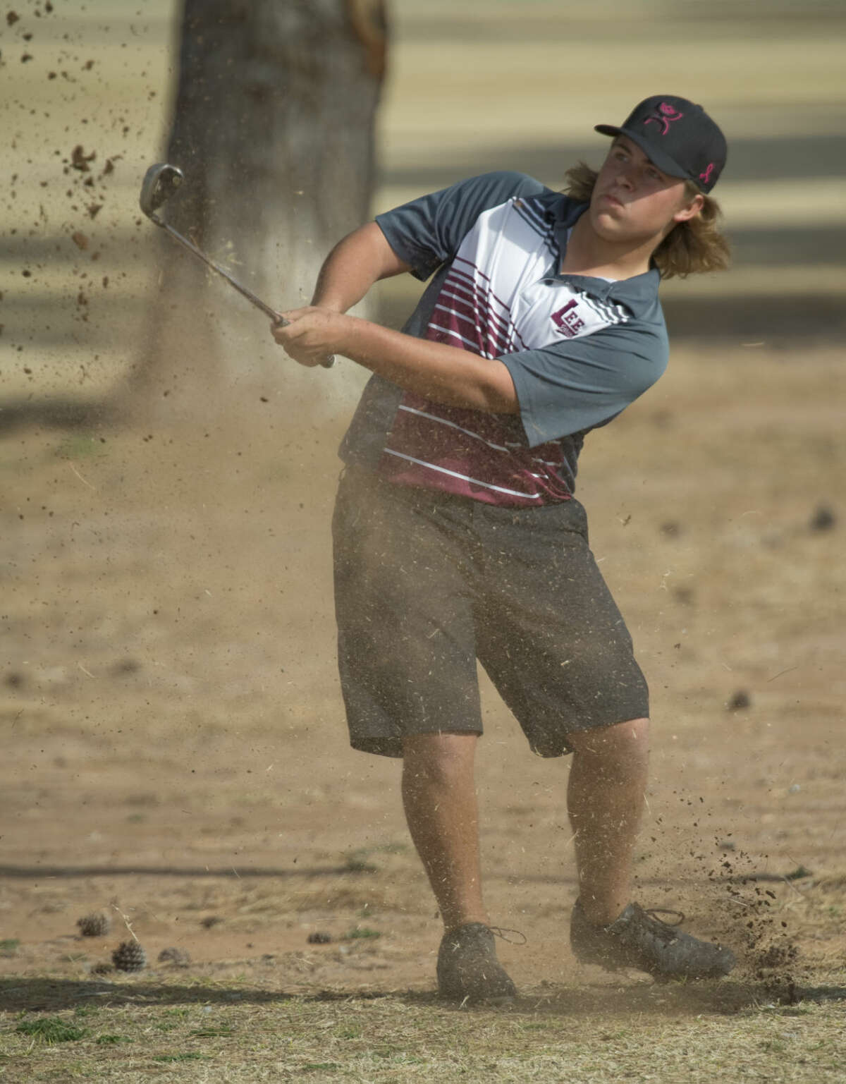 Lee High's Jared Arras chips toward the green Friday 02-19-16 during the Bobby Dunn Golf Invitational at Green Tree Country Club Tim Fischer/Reporter-Telegram