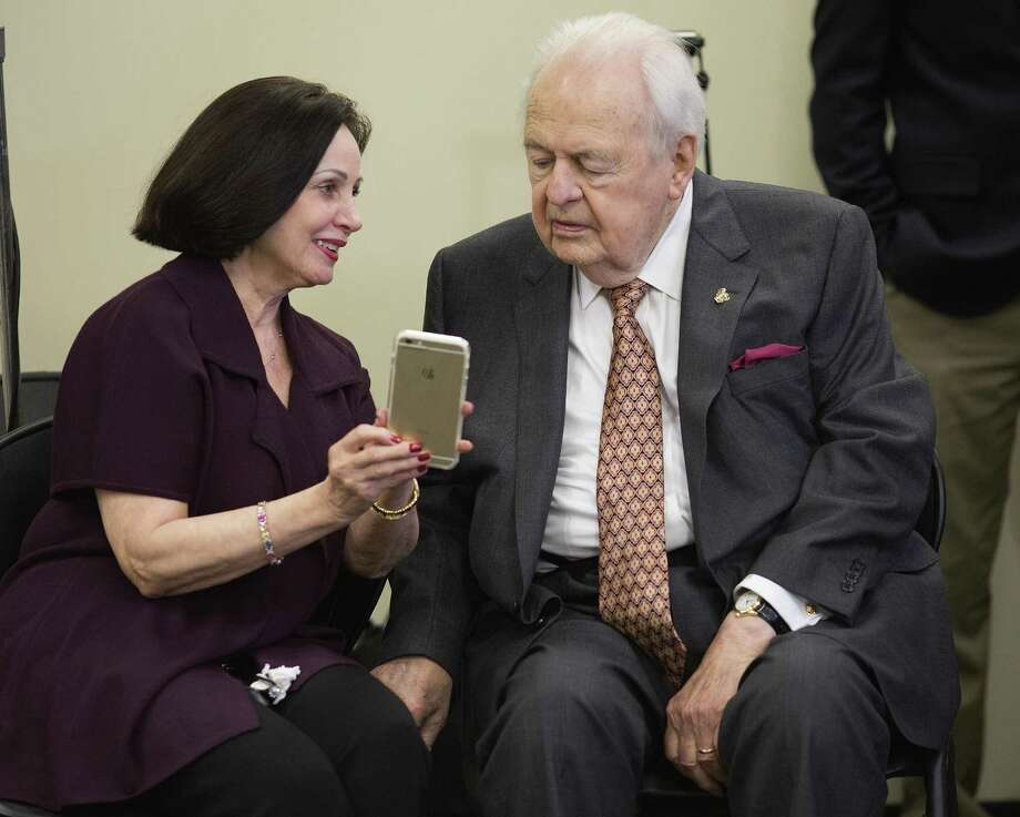 Tom Benson wants to remove daughter Renee Benson's shares of his New Orleans Saints and New Orleans Pelicans from a trust to ensure a smooth transition in passing the teams to his third wife, Gayle (above, with Benson last year), after his death. Photo: Associated Press / File Photo / FR171354 AP