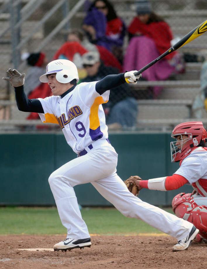 Midland High's Kohl Fritschen swings against Odessa High on Saturday at Zachery Field. James Durbin/Reporter-Telegram Photo: JAMES DURBIN