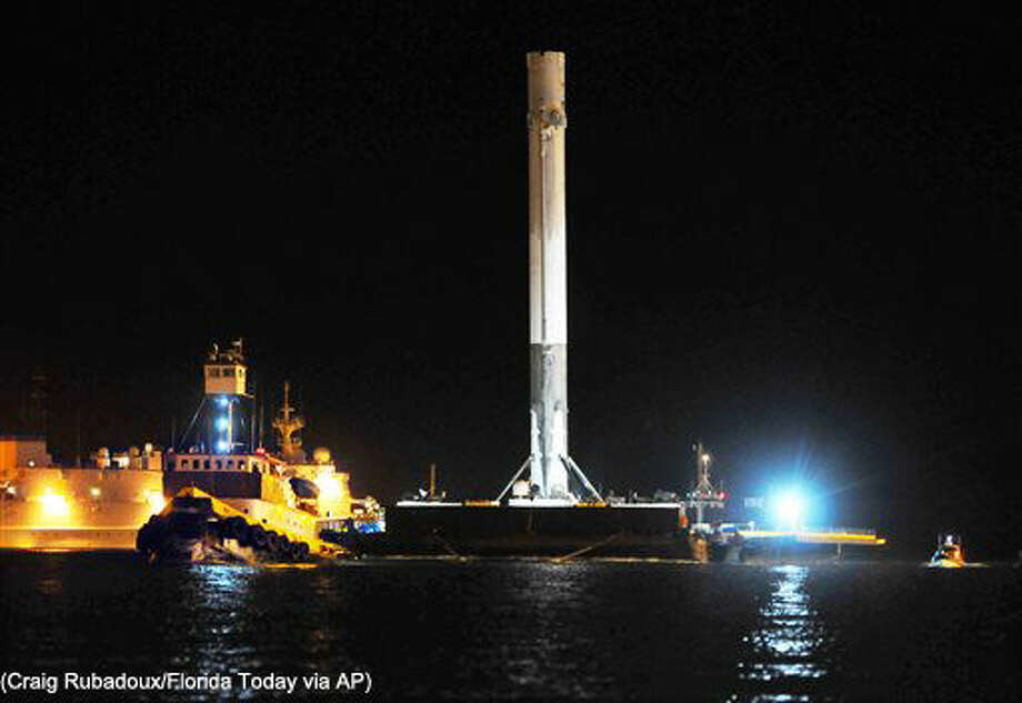 SpaceX Falcon 9 booster returns to Port Canaveral, Fla., early Tuesday, April 12, 2016. (Craig Rubadoux/Florida Today via AP) NO SALES; MANDATORY CREDIT Photo: Craig Rubadoux