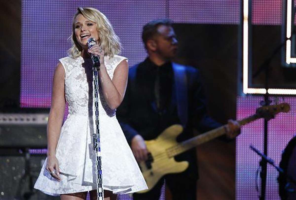 In this Dec. 2, 2014 file photo, Miranda Lambert performs during the CMT Artist of the Year Awards at the Schermerhorn Symphony Center in Nashville, Tenn. The ACMs announced Friday, Jan. 30, 2015, that Lambert is the top contender, including a nomination for entertainer of the year, pitting her against top-billing male stars Garth Brooks, Luke Bryan, Jason Aldean and Florida Georgia Line. Lambert is also nominated for album of the year for 'Platinum' and female vocalist of the year.