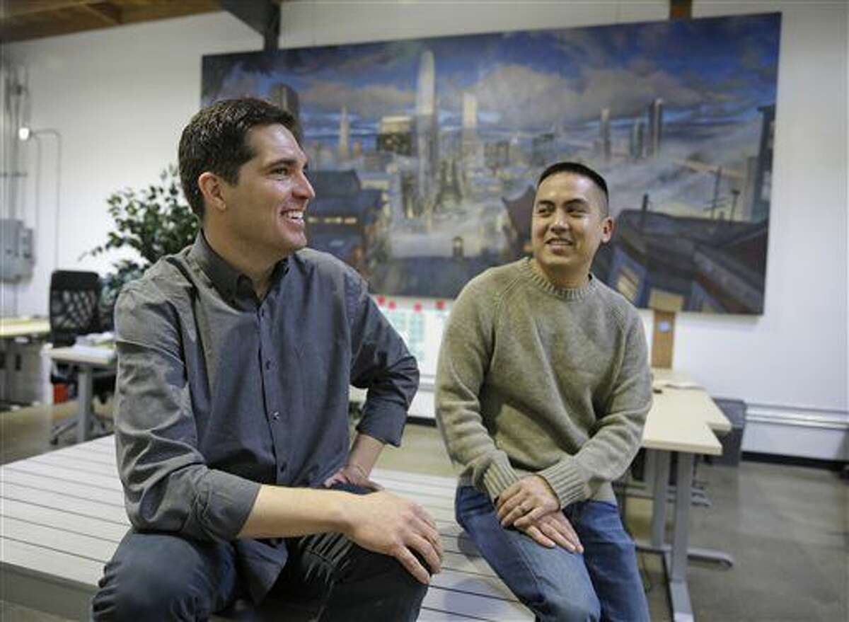 In this photo taken Monday, March 23, 2015, Vessel CEO and co-founder Jason Kilar, left, and co-founder Richard Tom pose for a photo at their headquarters in San Francisco.