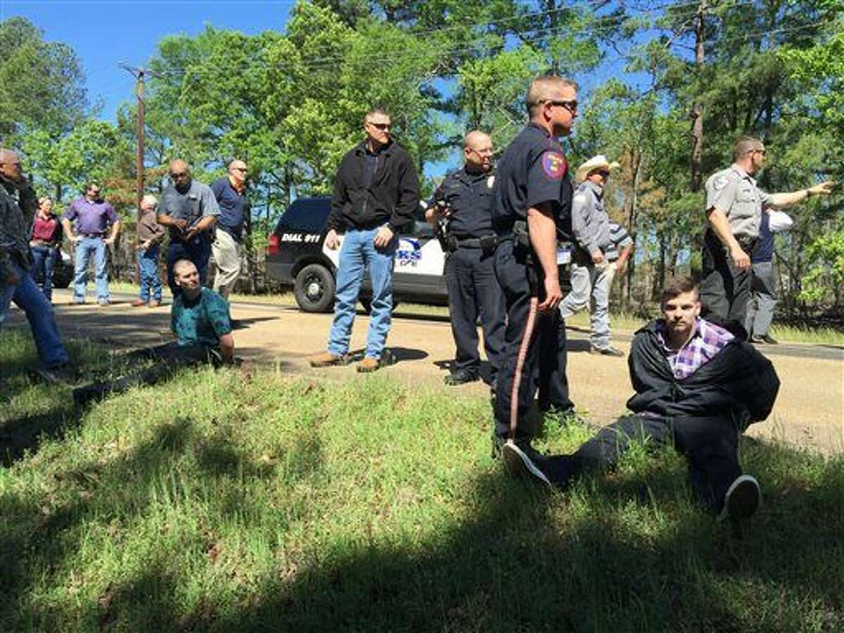 Keith Davis, 24, of Anderson Mo., right, and Matthew Miller, 22, of Eagle Rock, Mo., wait to be transported to the Bi-State Justice Building after Bowie County deputies captured the two escaped inmates, Tuesday morning April 12, 2016. The men where found on the TexAmerica's property, an industrial park about 25 miles West of Texarkana Texas. The inmates escaped the McDonald County jail in Pineville, Mo., sometime after 6 p.m. Sunday. (Evan Lewis/Texarkana Gazette via AP)