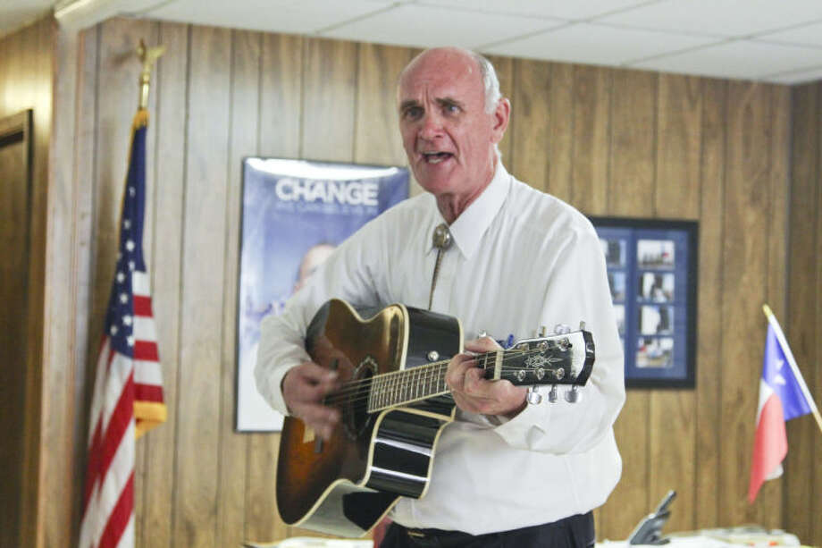 "Democrat John Cook strums his guitar as his sings ""I Won't Back Down"" during his state land commissioner campaign stop Sunday in Midland. Tyler White/Reporter-Telegram Photo: Tyler White"