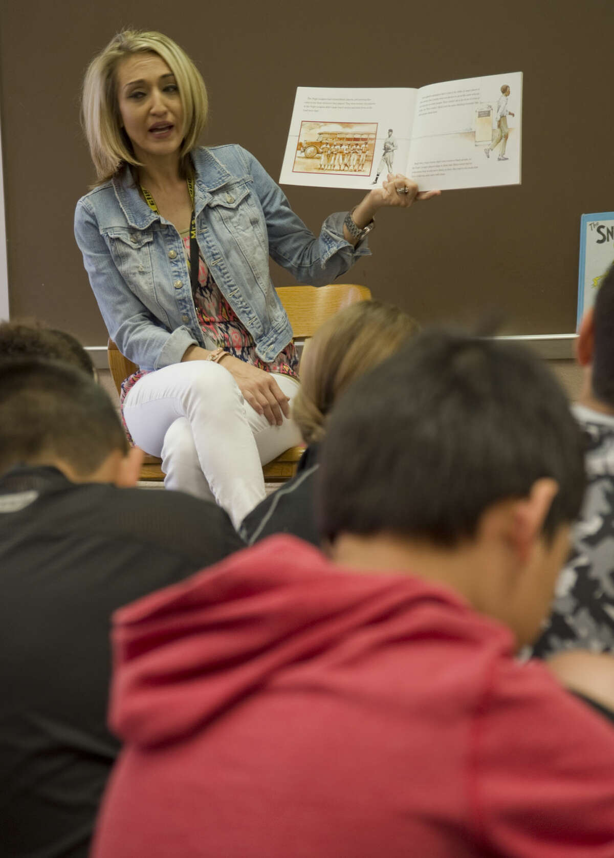 Santa Rita Elementary counselor Yvette Lozano reads a book about Jackie Robinson Thursday 04-07-16 as she talks with students about character traits. Tim Fischer\Reporter-Telegram