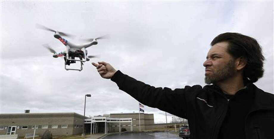 In this Feb. 13, 2014, photo, Jon McBride, who designs and builds drones with Digital Defense Surveillance, flies a training drone for members of the the Box Elder County Sheriff's Office search and rescue team, during a demonstration, in Brigham City, Utah. Law enforcement, government agencies and others are itching to use drones for everything from finding lost hikers to tracking shifting wildfires. But privacy watchdogs are urging state legislatures to step in and head off any potential privacy violations. That tension is on display as more than 35 states consider drone legislation this year, according to the National Conference of State Legislatures. The bills include ways to attract an industry that could generate billions and restrictions on drone use and data collection. (AP Photo/Rick Bowmer) Photo: Rick Bowmer / AP