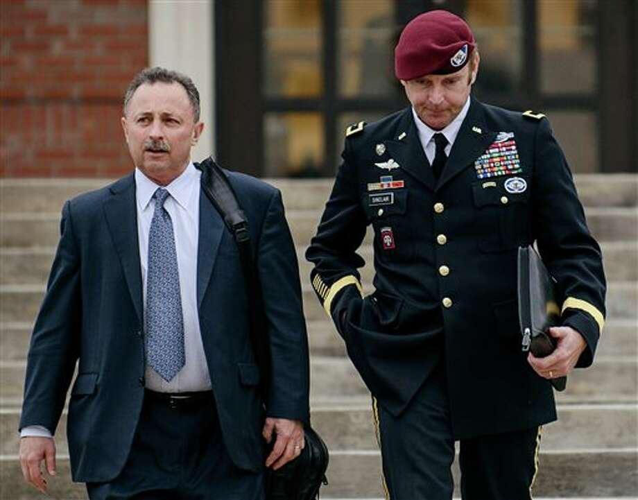 FILE - In this March 4, 2014, file photo, Brig. Gen. Jeffrey Sinclair, right, leaves the courthouse with his lawyers Richard Scheff, left, and Ellen C. Brotman, not pictured, following a day of motions at Fort Bragg, N.C. A military judge declined Monday, March 10, 2014, to dismiss sexual assault charges against Sinclair after reviewing what he said was evidence that political considerations influenced the military's handling of the case. (AP Photo/The Fayetteville Observer, James Robinson, File) Photo: James Robinson / The Fayetteville Observer