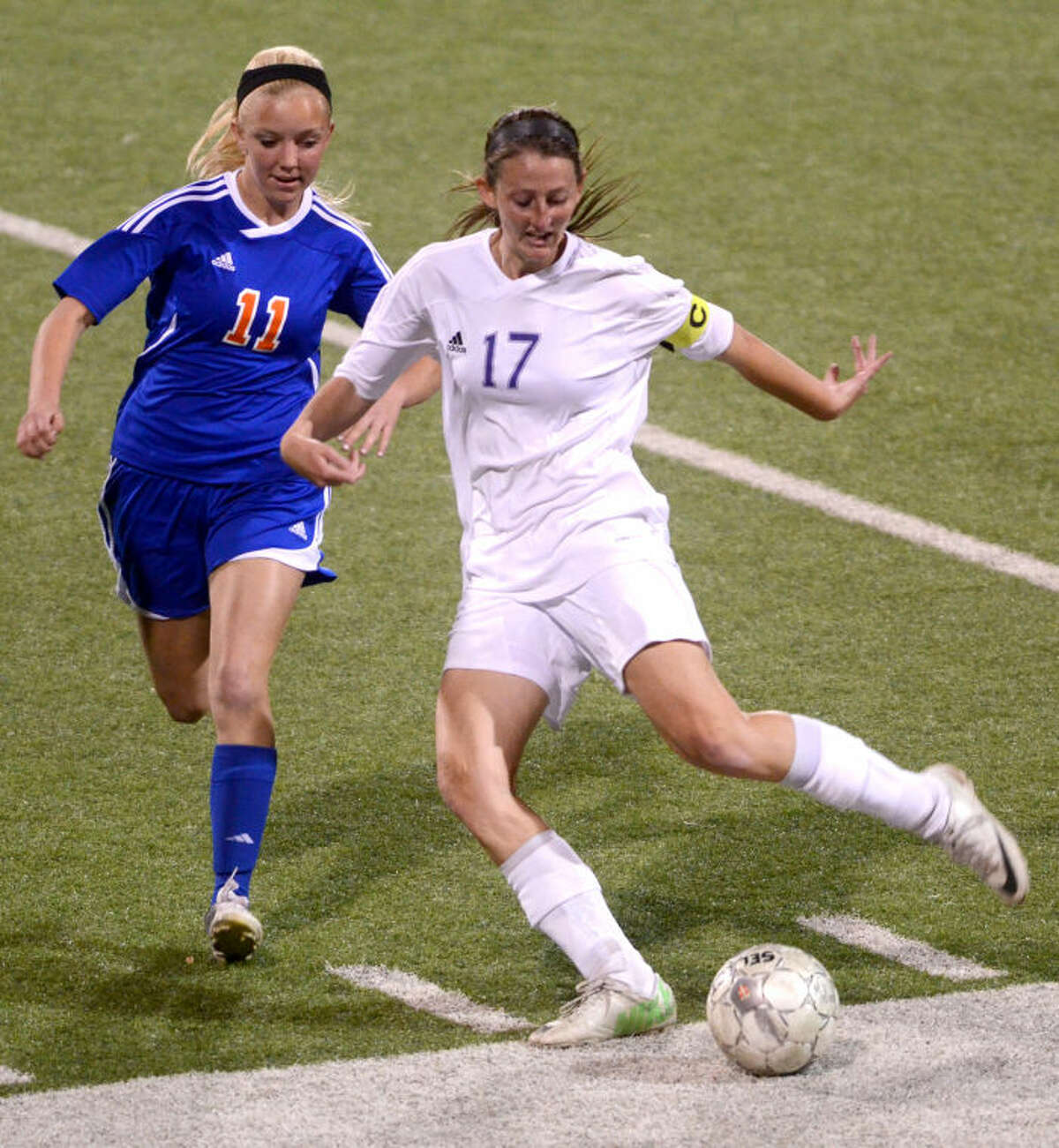 Midland High's Sarah Krisa (right) moves the ball down the field against San Angelo Central's Darci Wilson on Tuesday at Grande Communications Stadium. James Durbin/Reporter-Telegram