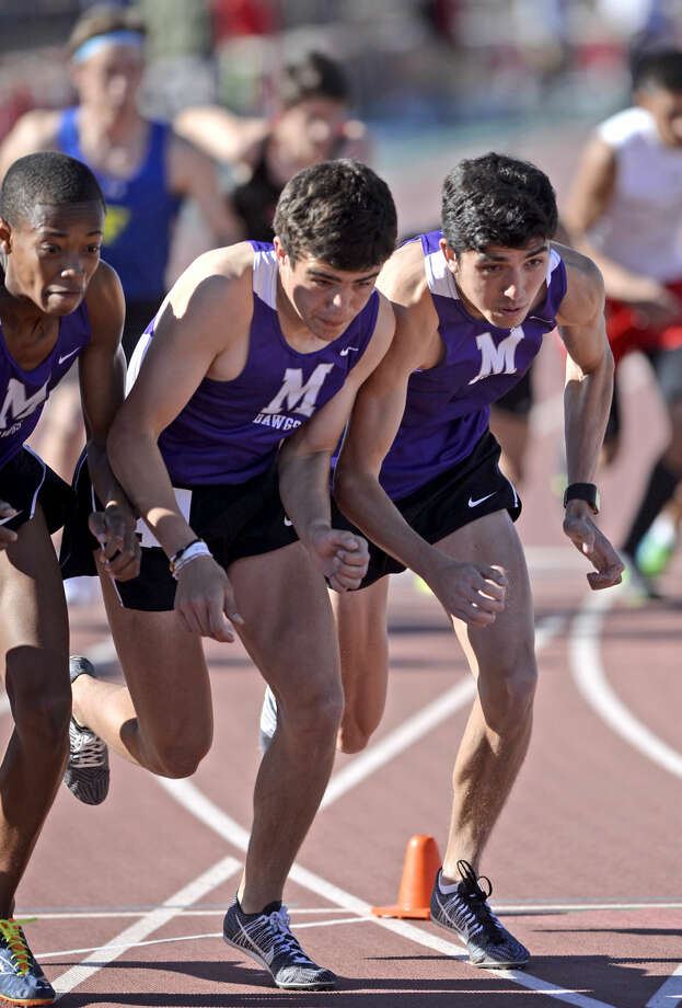 Midland High 800 meter runners from left, Jaylen Tryon, Cade Michael, and Bryce Hoppel take off from the start during the Tall City Relays track and field meet on Thursday, March, 24, 2016, at Memorial Stadium. James Durbin/Reporter-Telegram