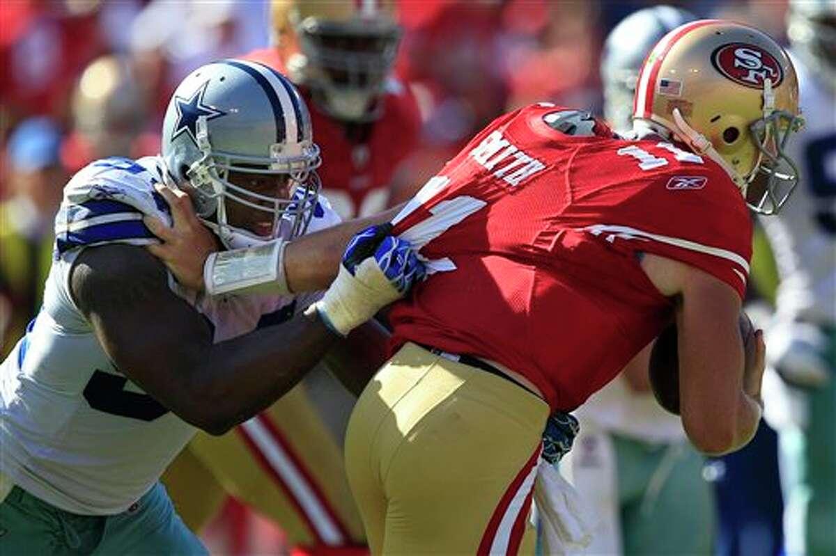 Dallas Cowboys outside linebacker DeMarcus Ware, left, sacks San Francisco 49ers quarterback Alex Smith (11) in the fourth quarter of an NFL football game in San Francisco, Sunday, Sept. 18, 2011. (AP Photo/Marcio Jose Sanchez)